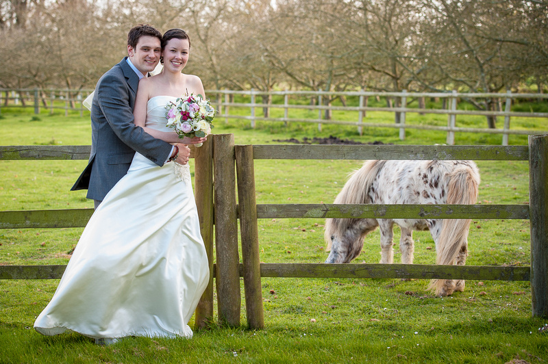 La Mare vineyards bride & Groom and horse in field